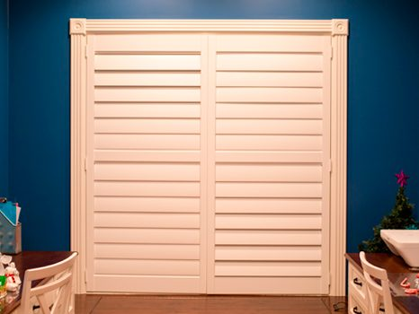 blue painted room in Naperville with white shutters on windows