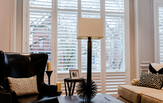 living room in Chicago with floor to ceiling shutters