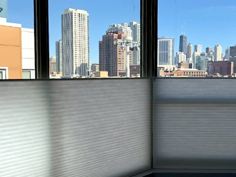 top down shades with city view floor to ceiling windows Chicago IL