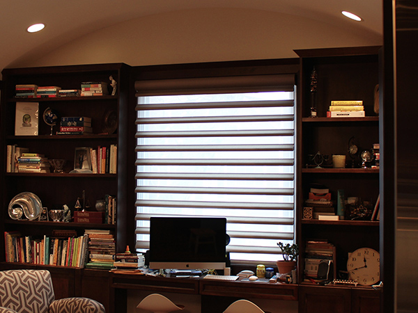 office with white walls and hunter douglas blackout pirouette window shades in Portland 97201