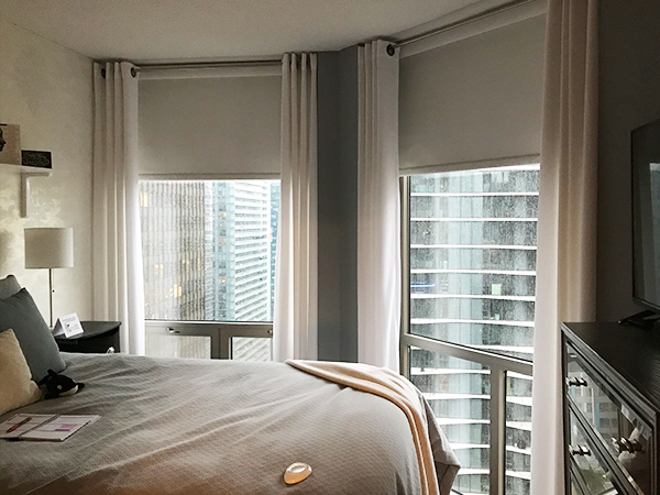 bedroom with motorized blinds skyline window coverings