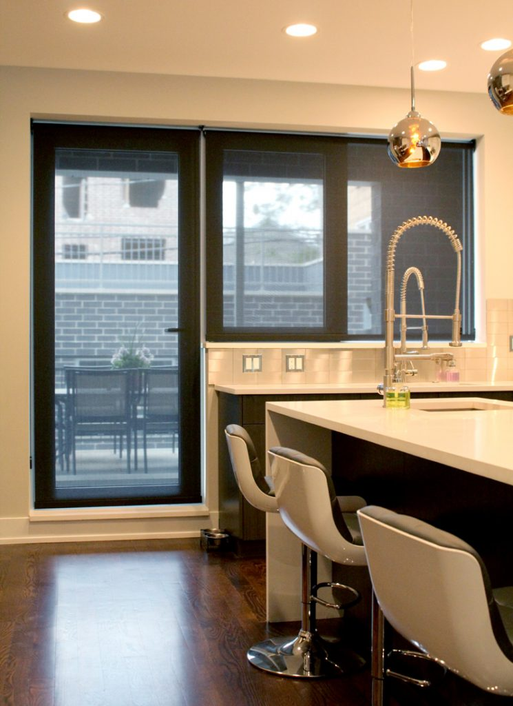 black screen roller shades on kitchen door for outdoor patio in Chicago IL