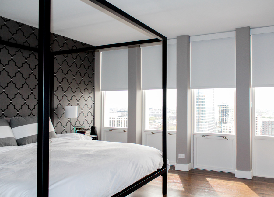 white bedroom brown wallpaper accent wall, white floor to ceiling roller shades in Chicago IL