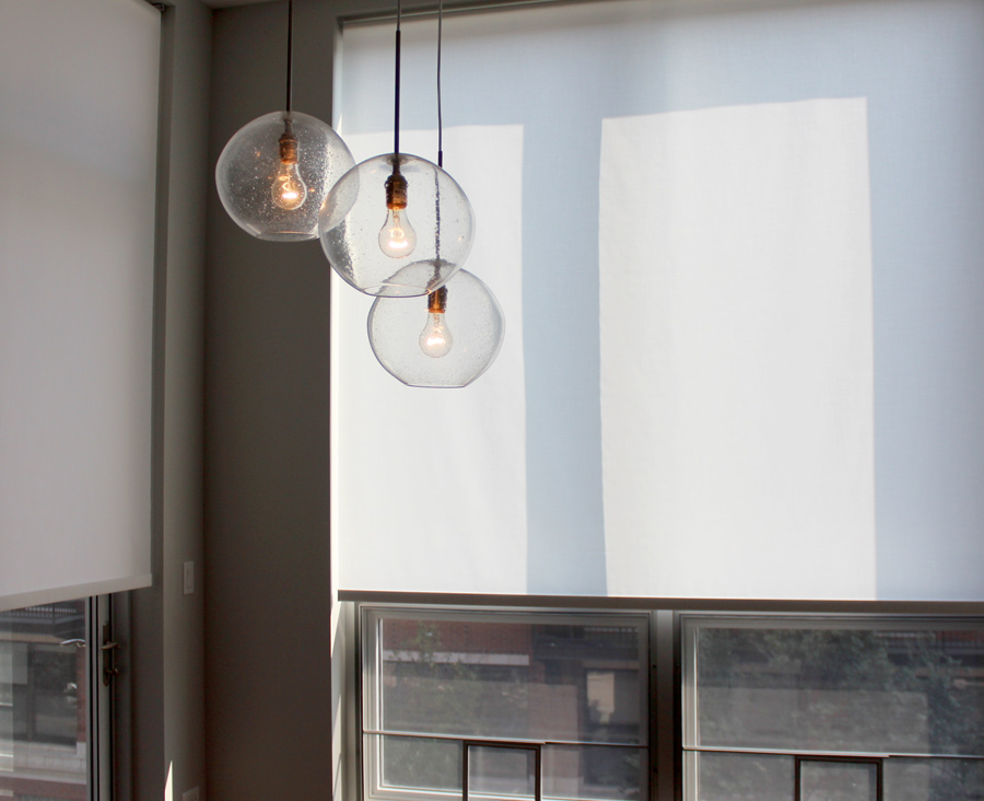 white roller shades with modern lighting in Chicago IL