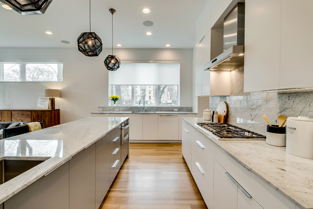 white kitchen with gray island and white roller shades in Chicago IL
