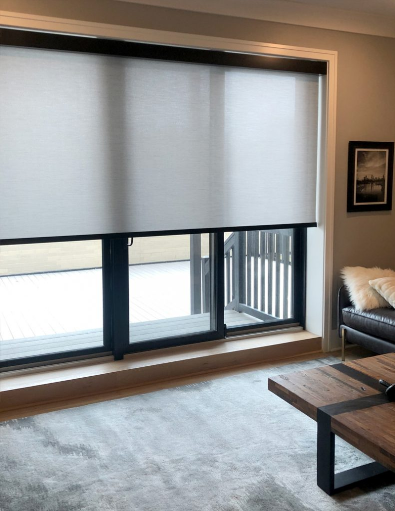 gray roller shades over black frame sliding doors in Chicago IL