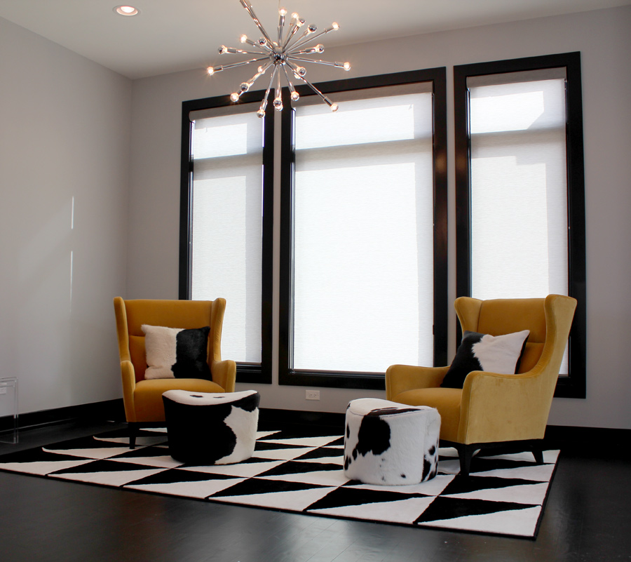 black, white and yellow theme in Chicago IL home with white roller screen shades