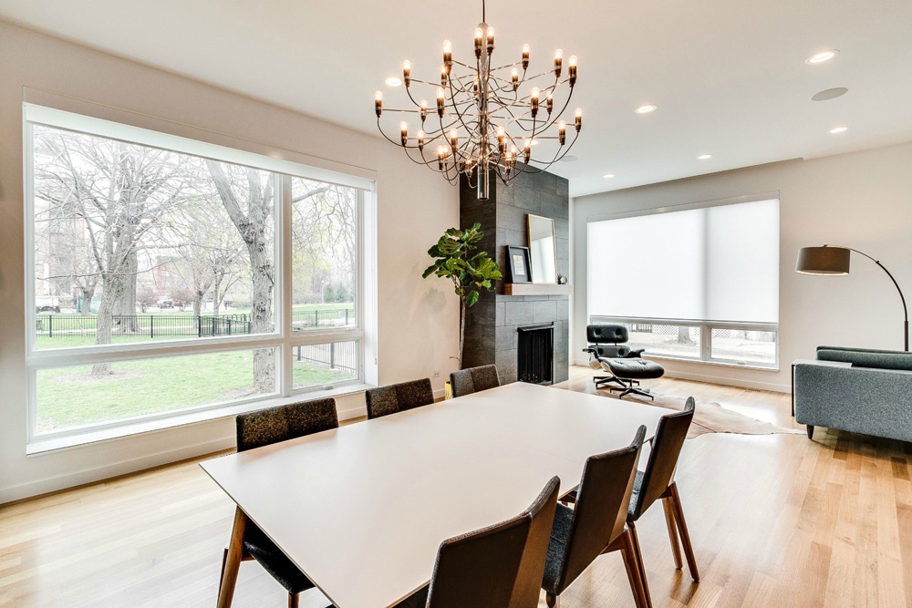 white screen roller shades in open floor plan home in Hinsdale IL