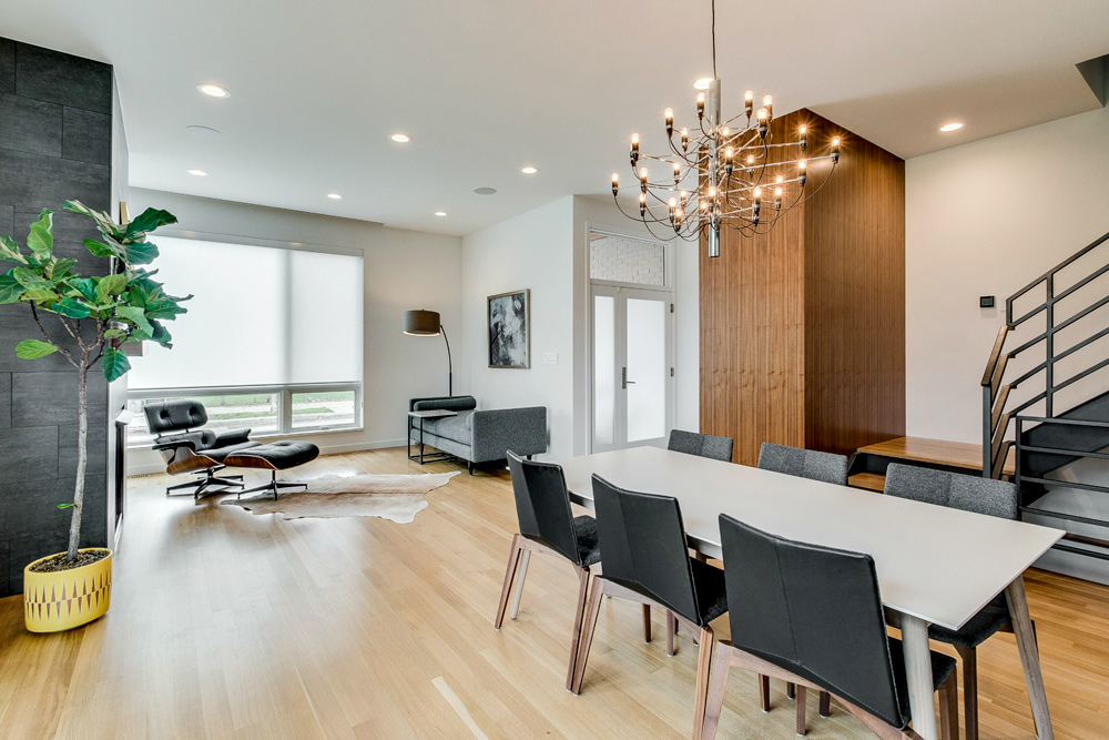open floor plan contemporary home with roller shades on living room window in Chicago IL