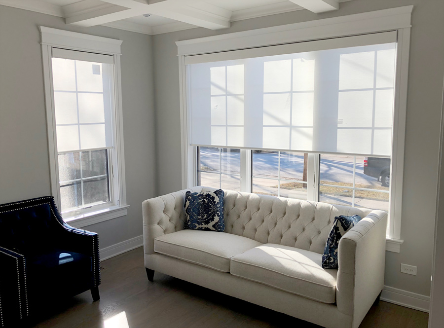 white roller shades in Chicago IL living room with white couch