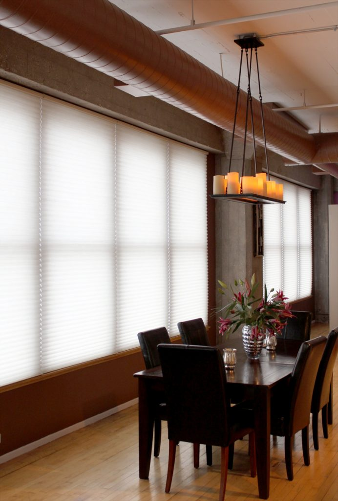 urban industrial loft with wall to wall windows covered with cellular shades in Chicago IL