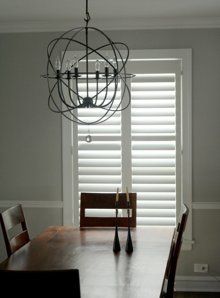 dining room with large window with white shutters in Chicago home