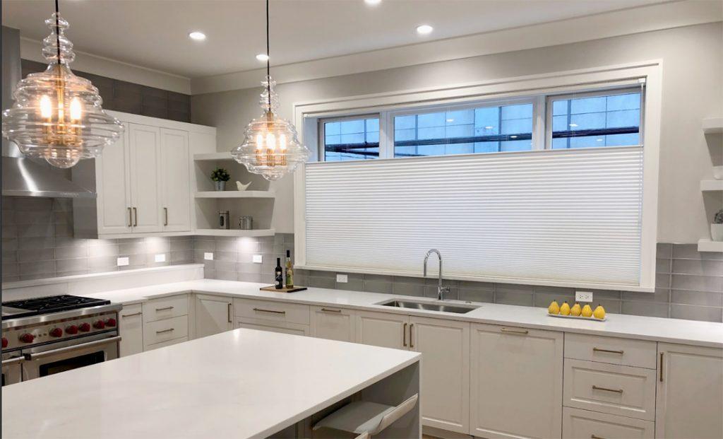 top down shades on kitchen window behind sink in modern white kitchen