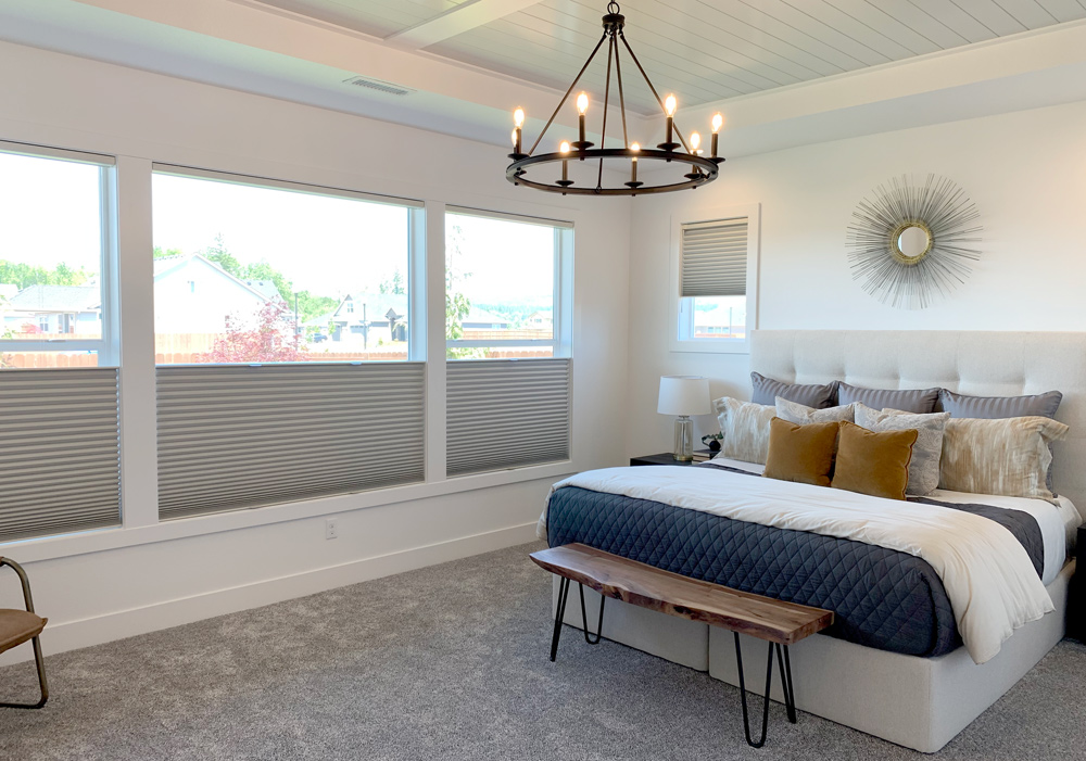 master bedroom with white, gold and navy blue colors, windows with cellular shades in Portland OR