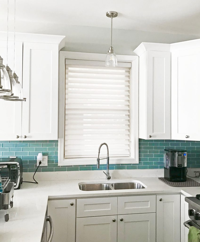 white silhouette shades on kitchen window above sink in Chicago home