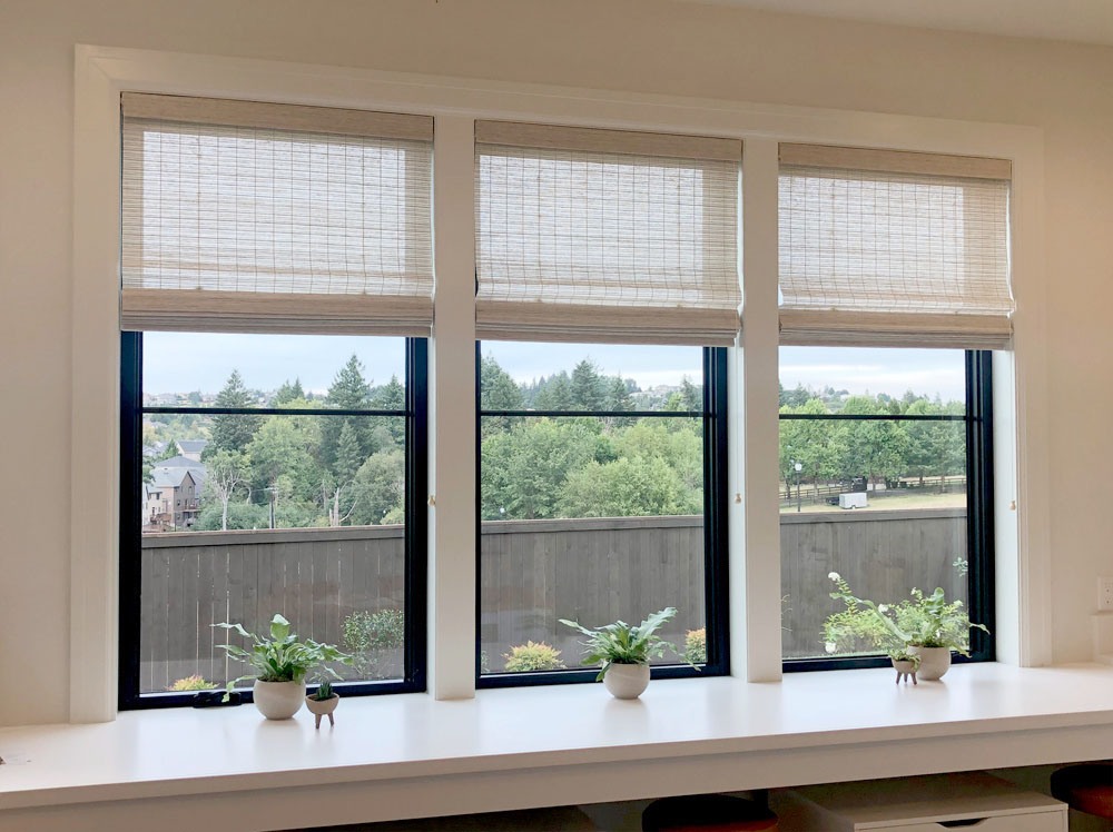 three windows in Portland home with woven wood shades