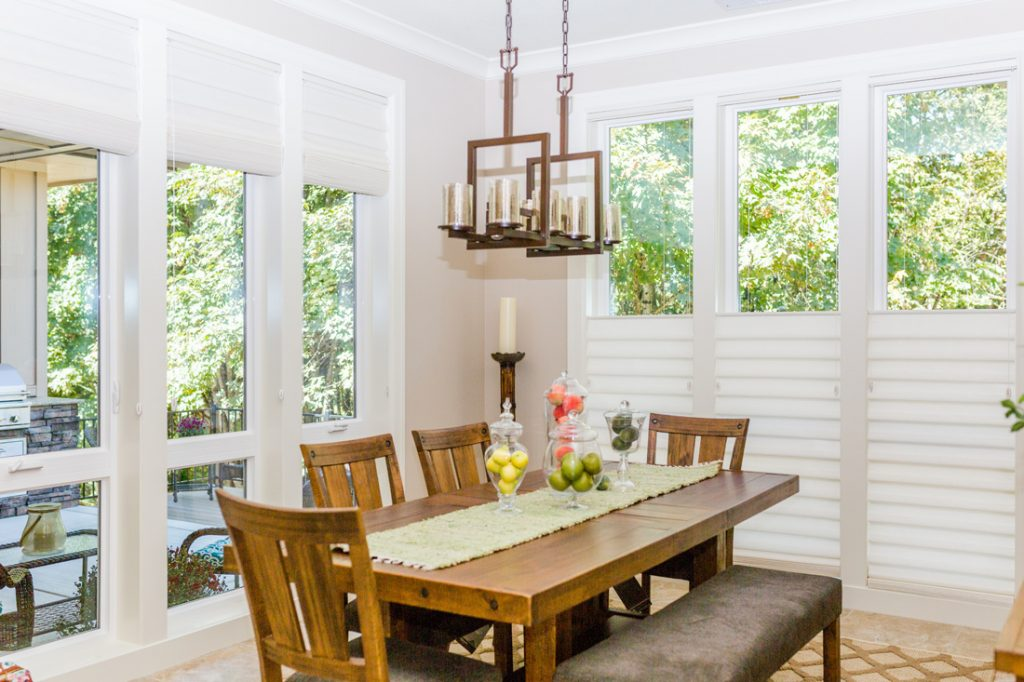 farmhouse style dining room with tall windows covered with roman shades in Portland OR home