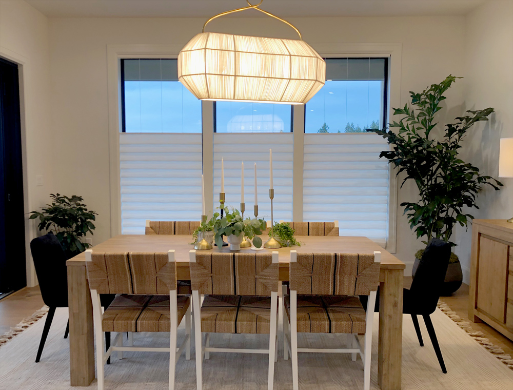 contemporary dining room with three windows covered with top down shades in Portland OR