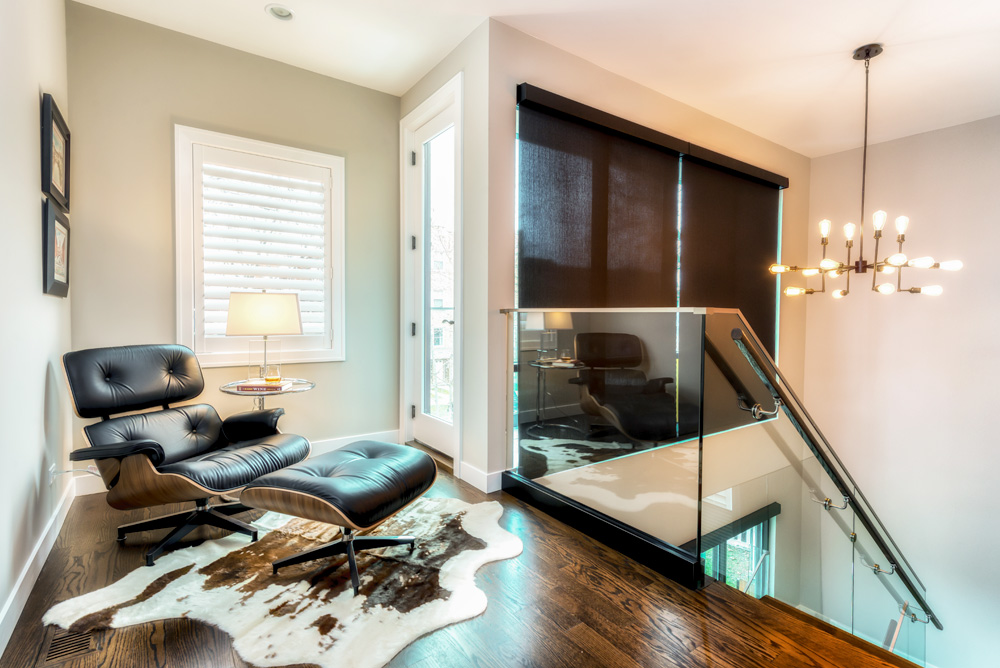 black roller shades in staircase in Chicago IL home