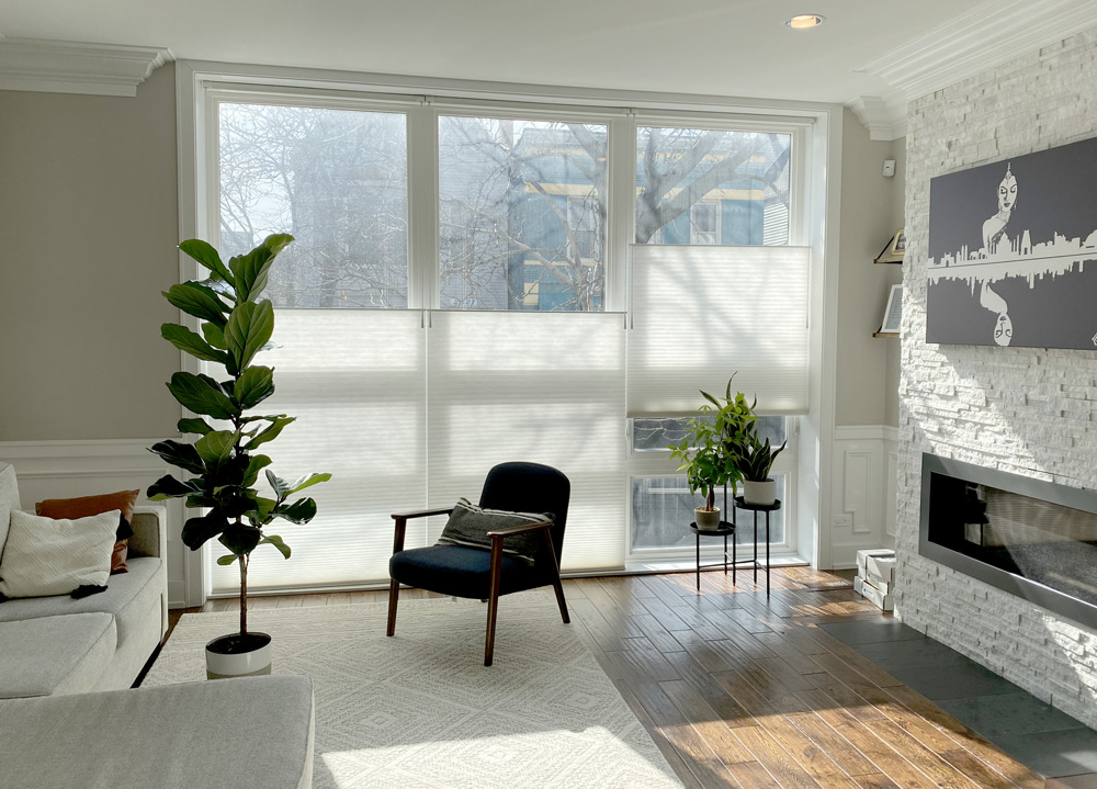 top down bottom up shades in cozy living room white duette honeycomb shades floor to ceiling windows Chicago IL