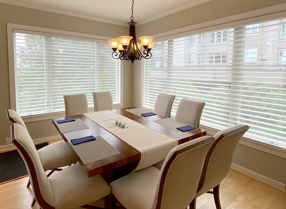dining room with large windows covered with see-through silhouette shades Naperville IL