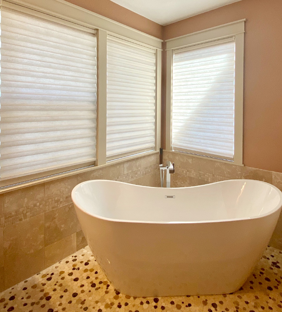 soft white solera roman shades in master bathroom in Vancouver WA