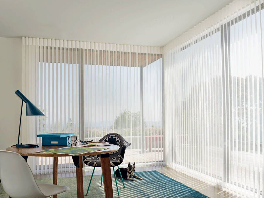Luminette view through sheer vertical shades allow for the perfect amount of light to come into your home office.