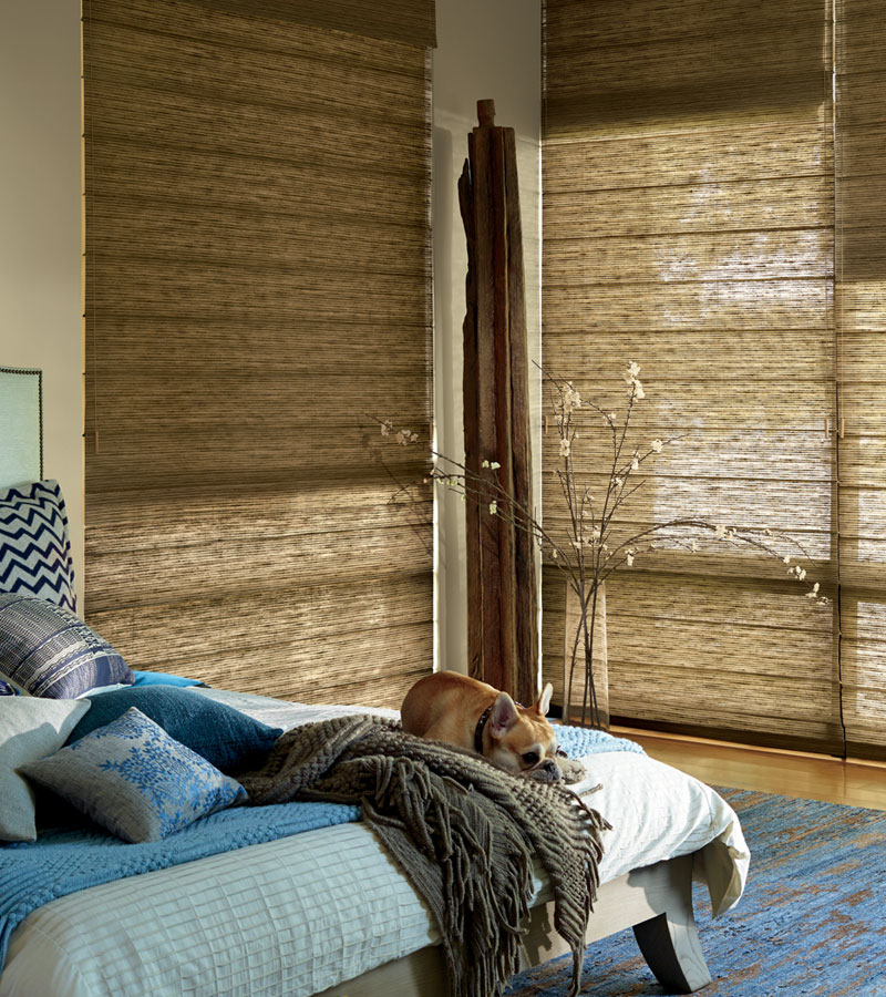 dual roman shades with woven fabrics in bedroom Portland OR