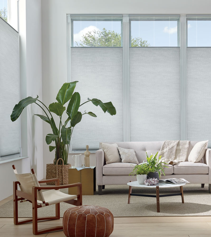 top down honeycomb shades in living room with high ceilings Hinsdale IL