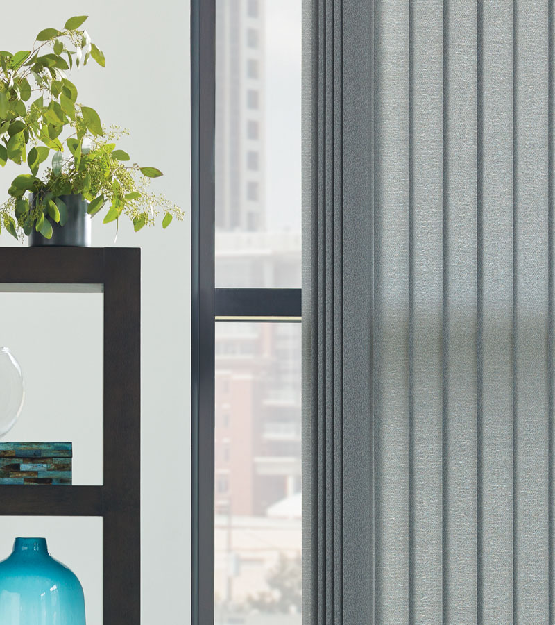 gray vertical blinds on large windows in Chicago IL