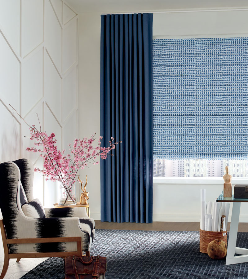 white board and batten feature wall with blue draperies and patterned roman shades Chicago 60657
