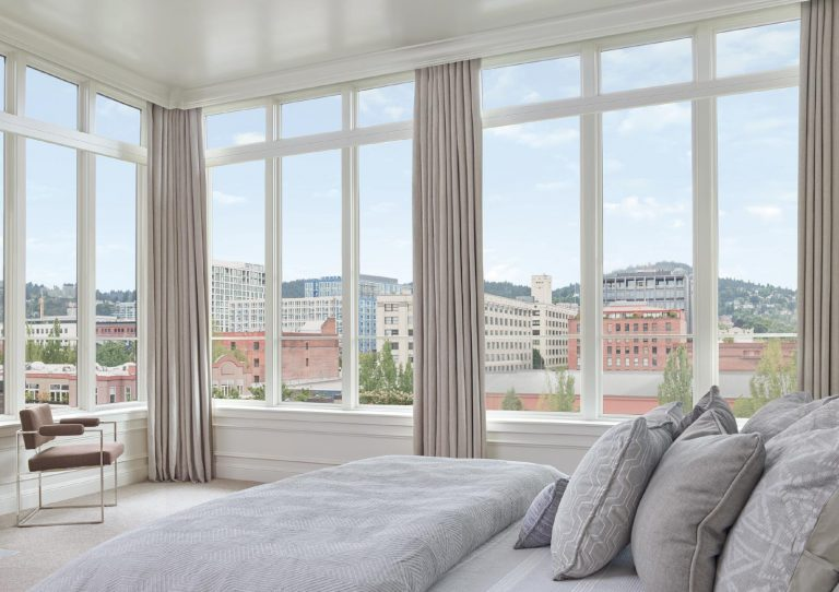 floor to ceiling windows with draperies in Portland OR
