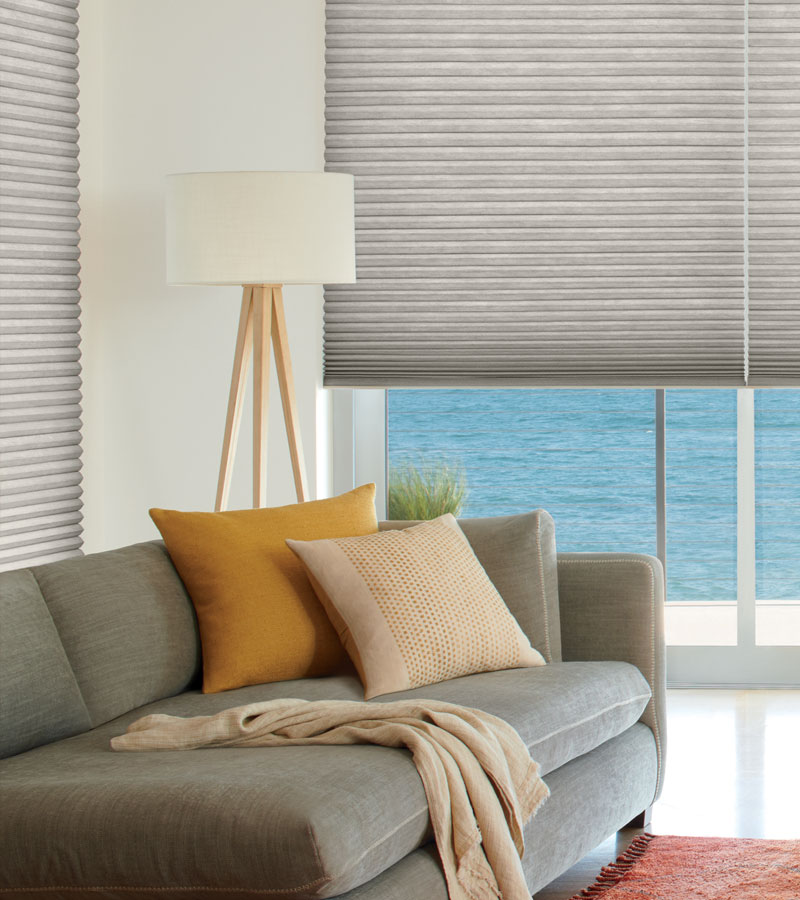 gray duette cellular shades in living room for energy savings in Portland OR home
