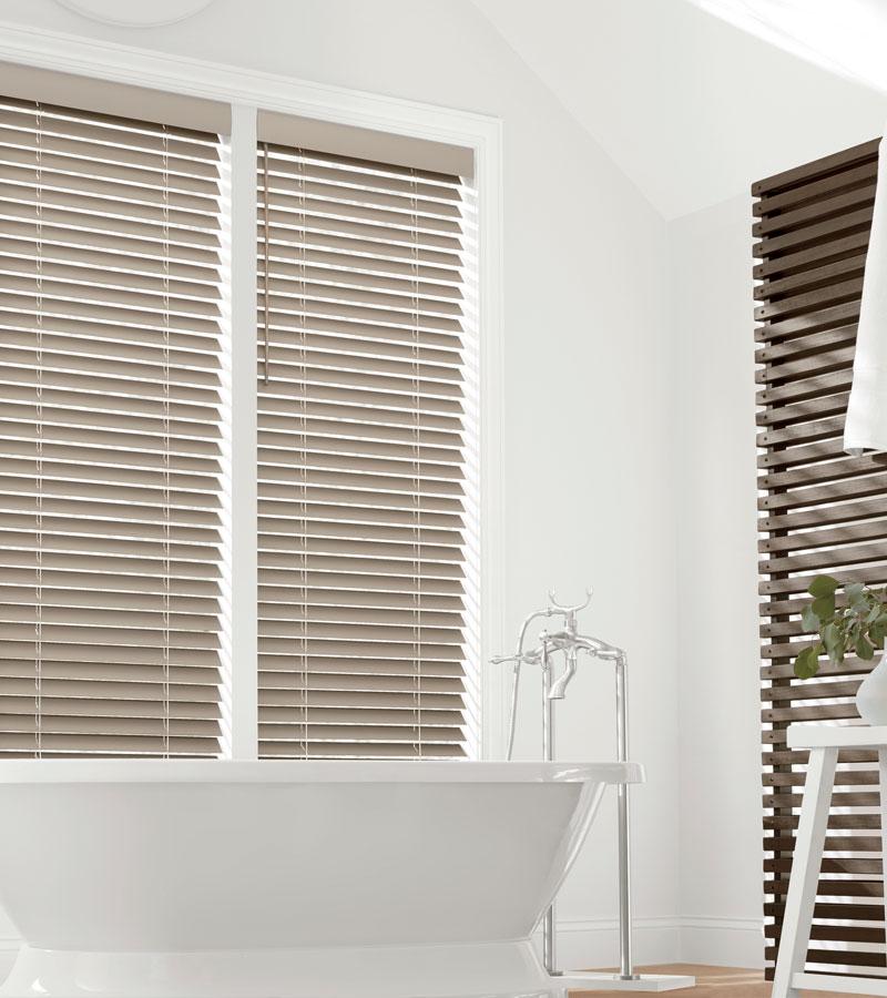 medium wood faux wood blinds in bathroom in Portland OR