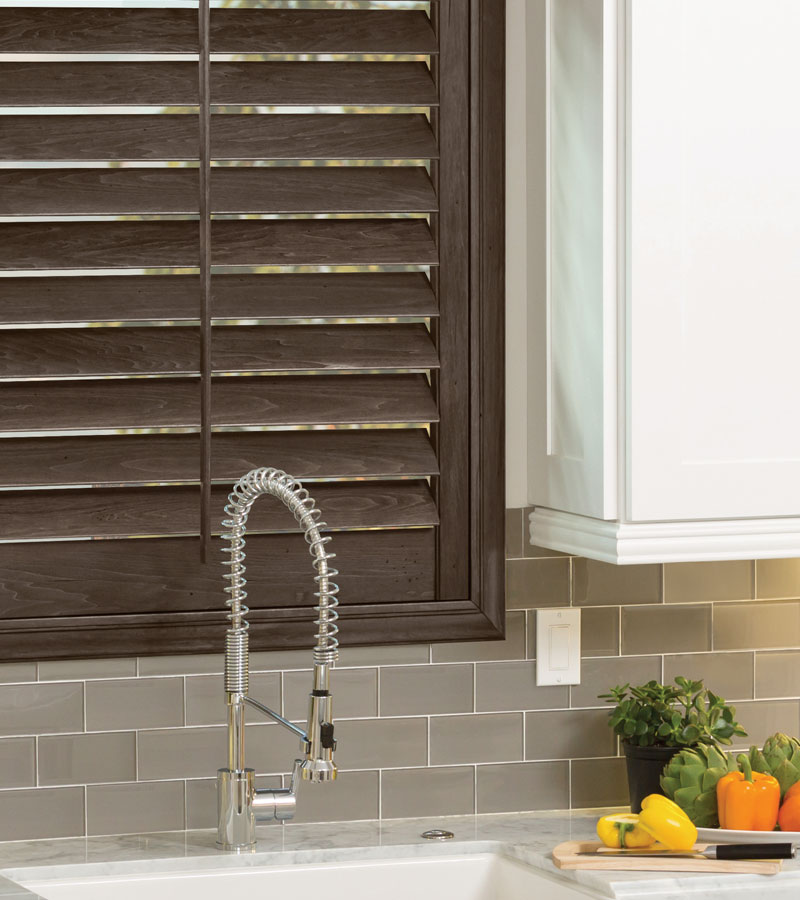 Portland OR kitchen window with hardwood shutters behind sink