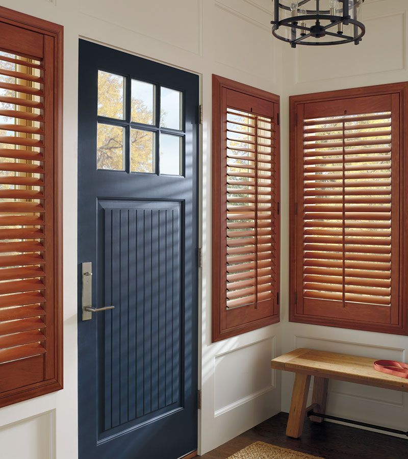 entryway windows covered with wood shutters in Portland OR
