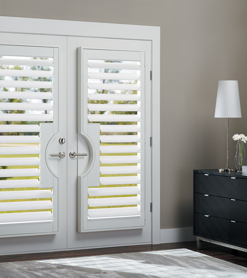 Hinsdale IL home with french door shutters with handle cutouts