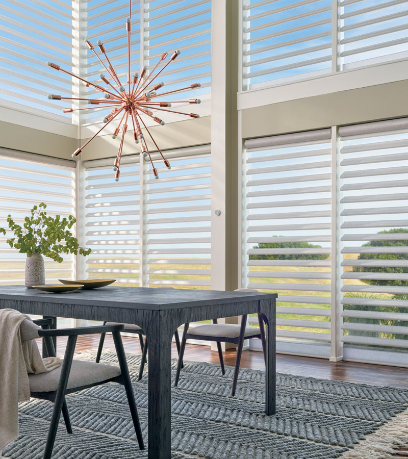 floor to ceiling windows with sheer and fabric pirouette shades in Vancouver WA home