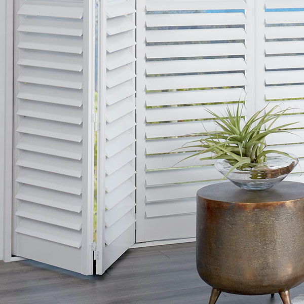 white bi-fold shutters for large windows and sliding doors in Vancouver WA