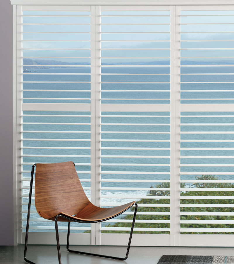 large window covered with white plantation shutters in Portland OR