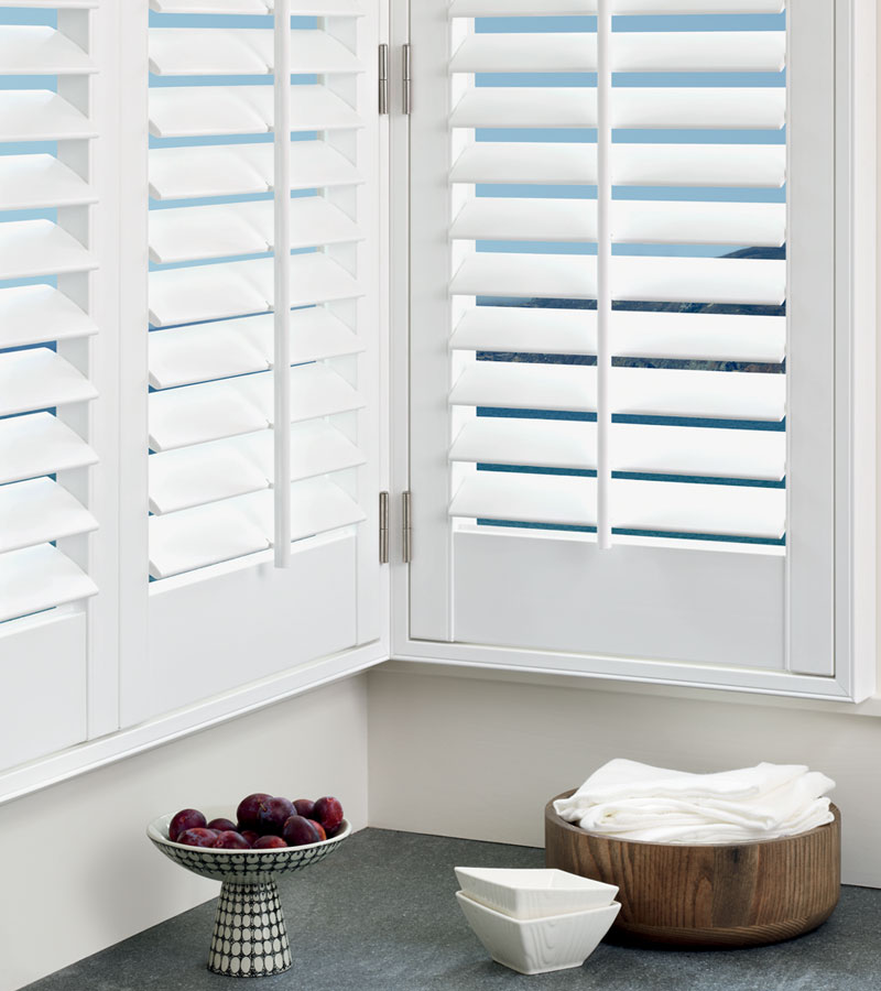 white window shutters with center tilt bar in the corner of the room in Vancouver WA