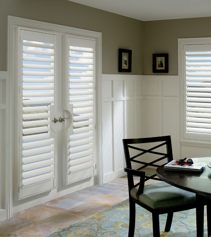 dining room with white interior shutters on french doors in Naperville IL home