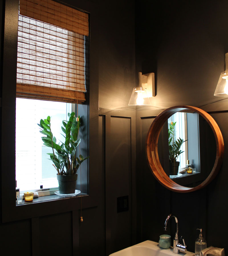 natural color woven wood shades in black bathroom Portland OR
