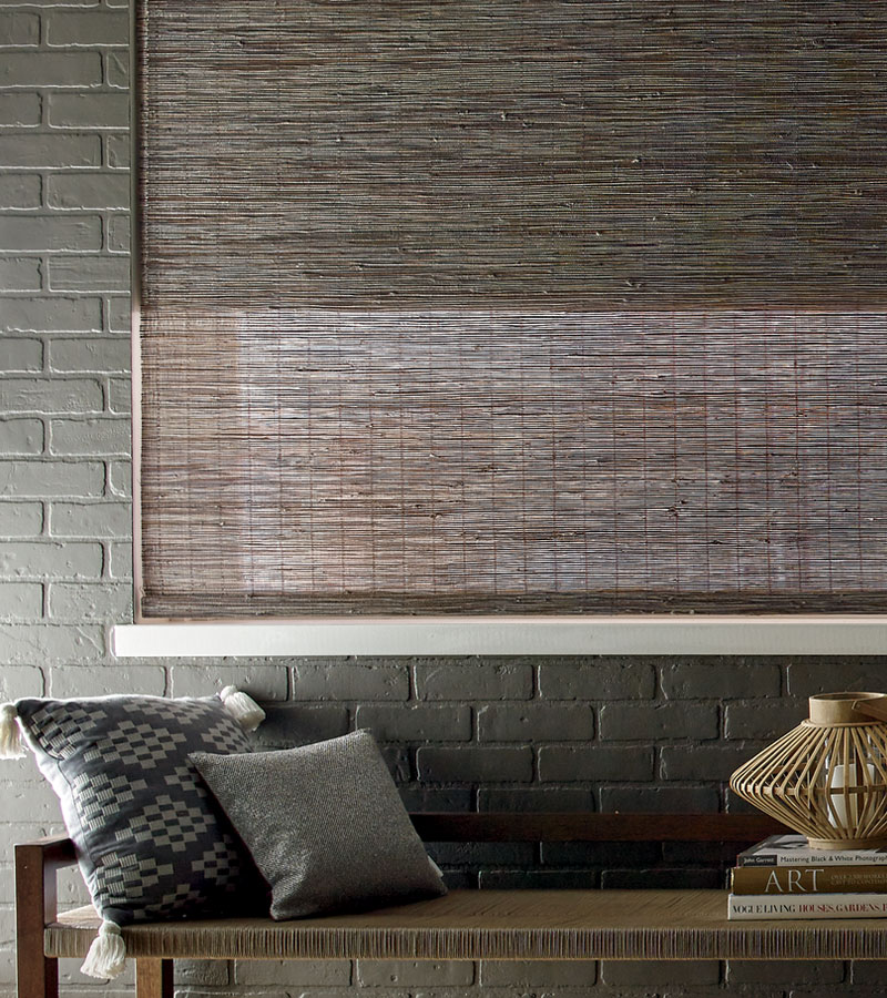 taupe woven wood shades with Brick wall in Chicago IL