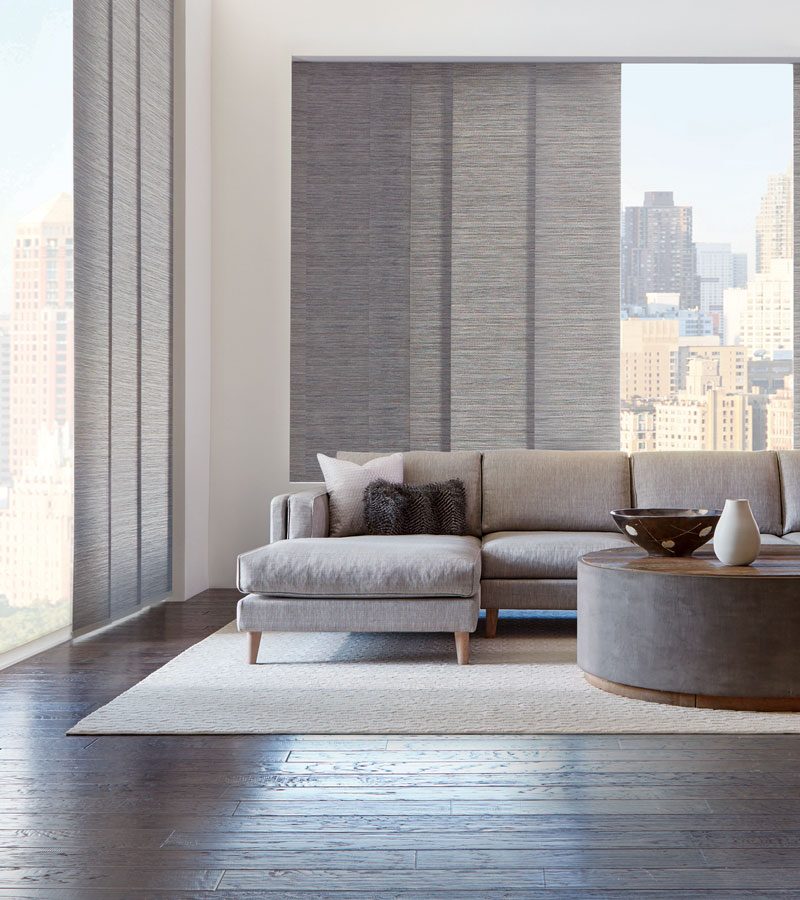 gray vertical shades on floor to ceiling windows in downtown Chicago condo