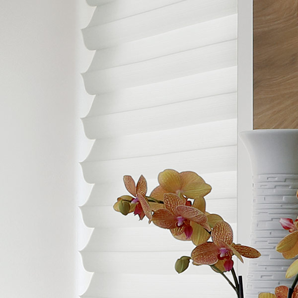 white fabric solera roman shades for light filtering and energy savings in Naperville IL