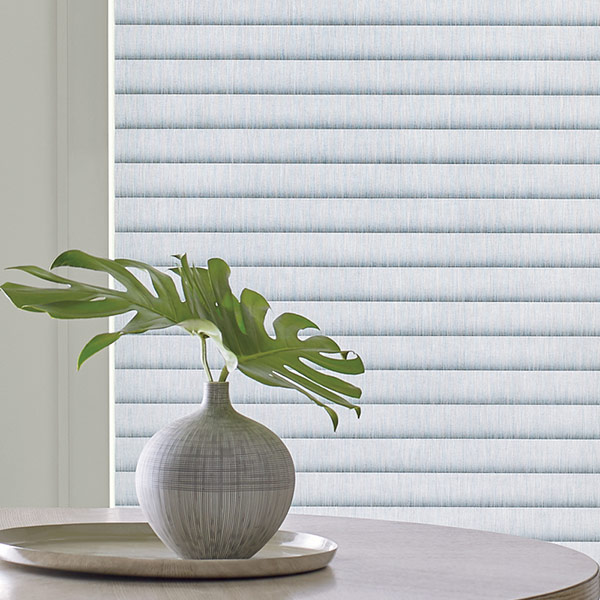 close up of new cellular roller shades with plant in Chicago IL