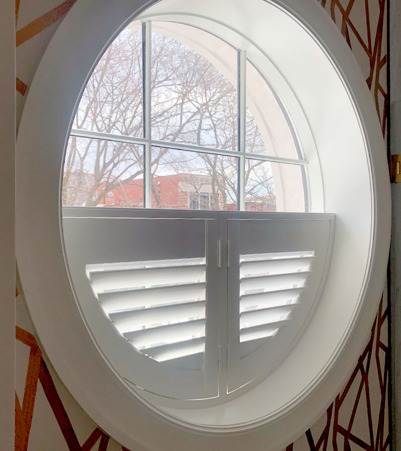 custom shaped window treatments plantation shutters on round window in Chicago IL