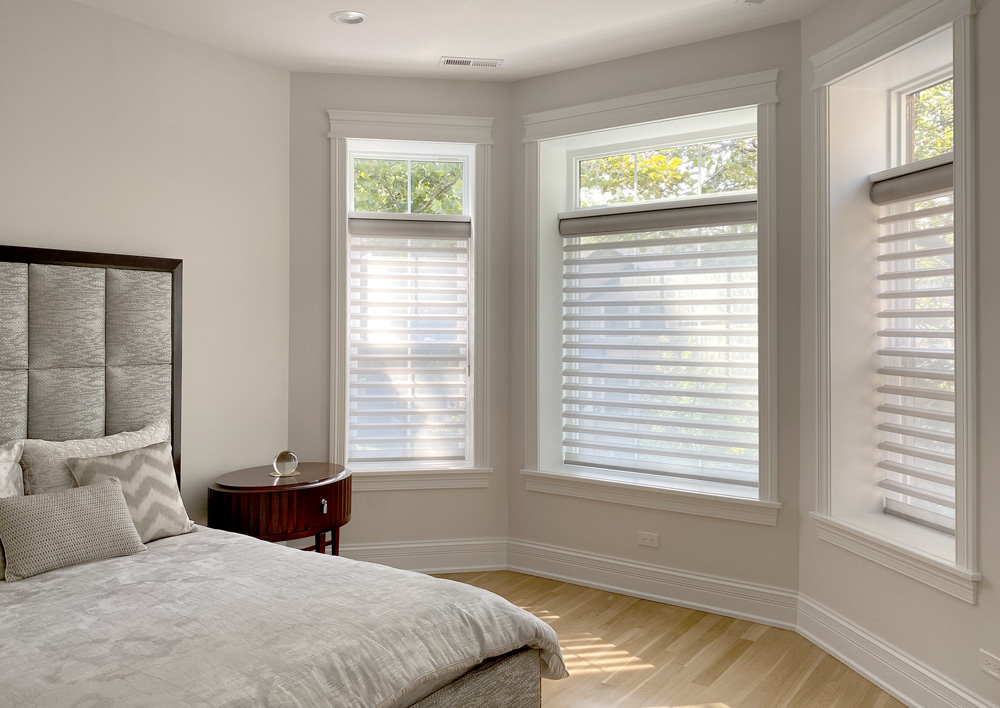 bedroom with bay window covered with sheer shades and open transom in Portland OR
