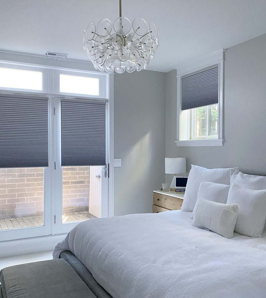 white bedroom with gray honeycomb shades on french doors in Chicago IL